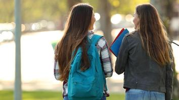 Two university students walking and talking