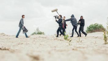 Behind the scene film crew filming movie scene outdoor